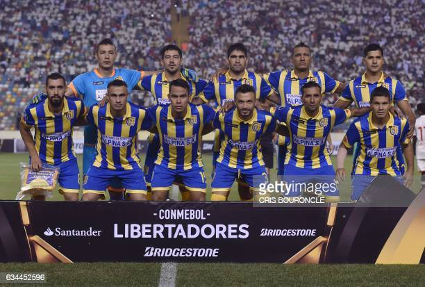 Paraguays Deportivo Capiata players pose for photographers before their Copa Libertadores football match against Peru's Universitario at the...