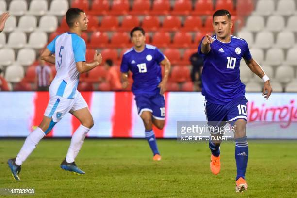 Paraguay's Derlis Gonzalez celebrates after scoring during a friendly football match between Paraguay and Guatemala at the Defensores del Chaco...