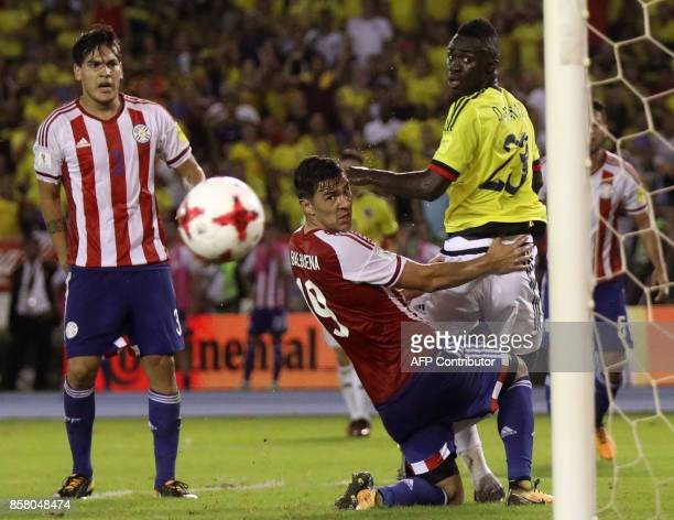 Paraguay's Fabian Balbuena and Colombia's Davinson Sanchez eye the ball during their 2018 World Cup football qualifier match in Barranquilla Colombia...