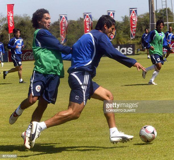 Paraguay's football team player Roque Santa Cruz and a U20 player vie for the ball on September 7 2008 in Ypane Paraguay before a training session...