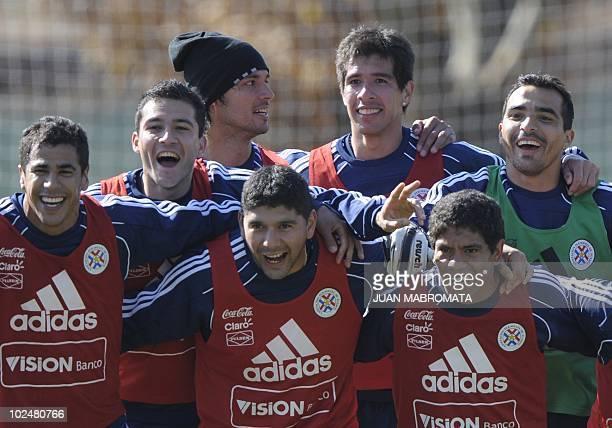 Paraguay's footballers defender Carlos Bonet midfielder Nestor Ortigoza and forward Rodolfo Gamarra defender Antolin Alcaraz forward Roque Santa Cruz...