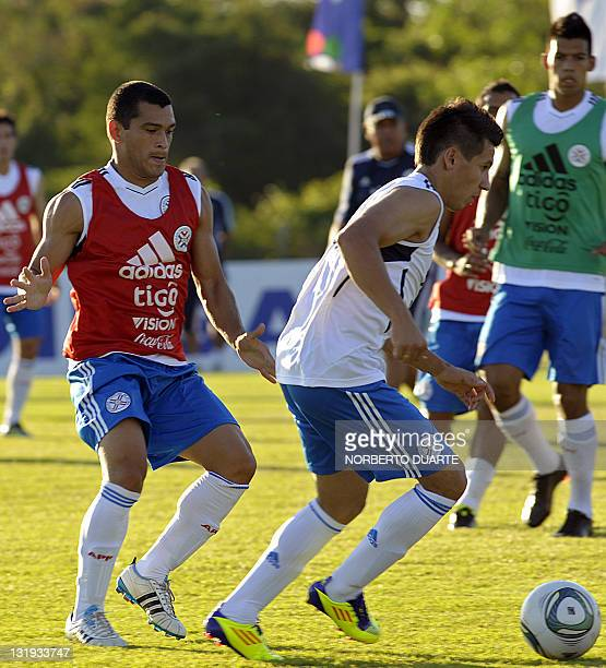Paraguay's footballers Hernan Perez and Miguel Samudio vie for the ball during a training session in Ypane near Asuncion on November 8 2011 Paraguay...