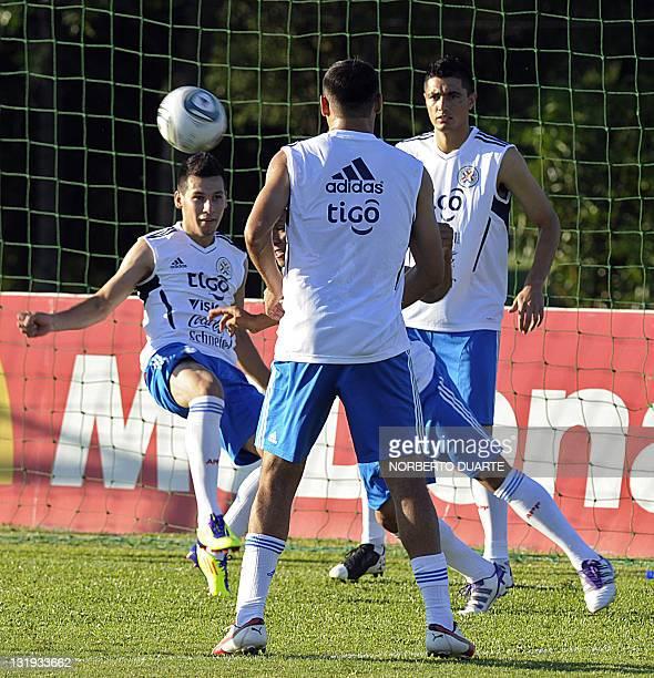 Paraguay's footballers Hernan Perez Oscar Tacuara Cardozo and Paulo Da Silva train in Ypane near Asuncion on November 8 2011 Paraguay will face...