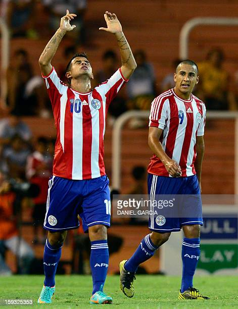 Paraguay's forward Derlis Gonzalez ceebrates next to teammate forward Cecilio Dominguez after scoring against Argentina during their South American...