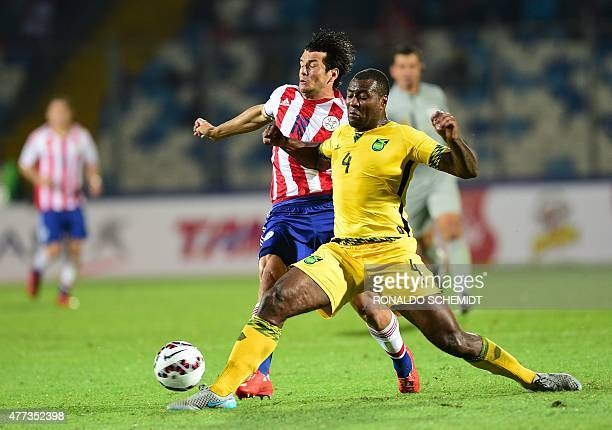 Paraguay's forward Nelson Haedo Valdez and Jamaica's defender Wesley Morgan vie during their 2015 Copa America football championship match in...