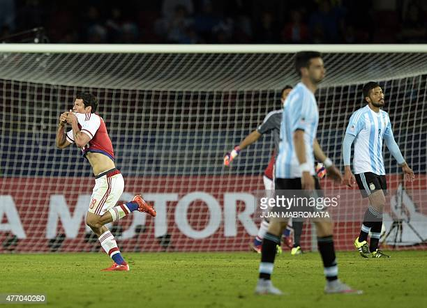 Paraguay's forward Nelson Haedo Valdez celebrates after scoring against Argentina during their 2015 Copa America football championship match in La...