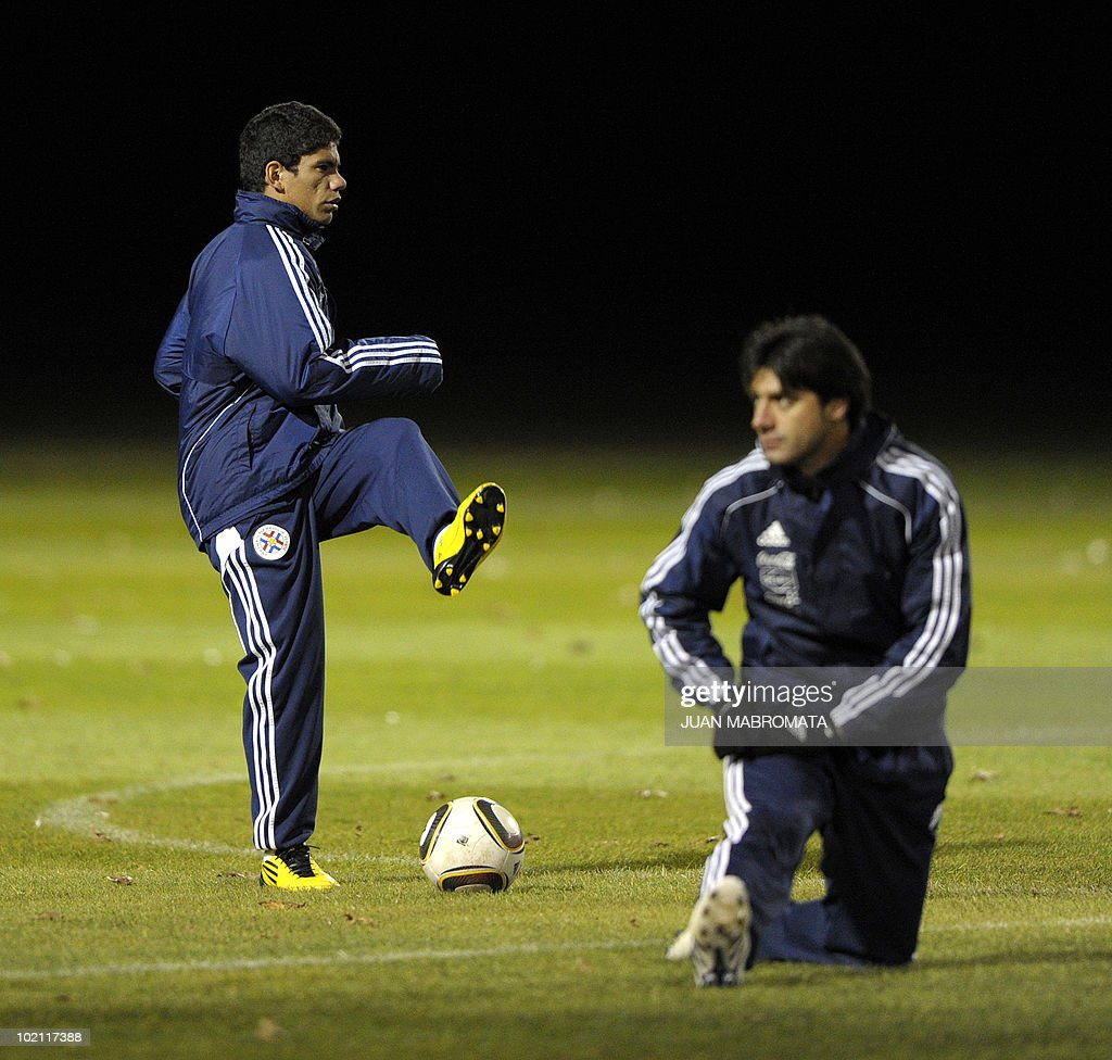 Paraguay's forward Rodolfo Gamarra (L) warms up next to defender Julio Cesar Caceres during a training session at Michaelhouse school in Balgowan on June 15, 2010 a day after their first match against Italy ended 1-1 and ahead their second 2010 World Cup Group F football match against Slovakia on June 20 at Free State stadium in Bloemfonstein.