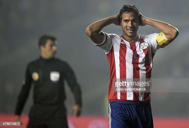 Paraguay's forward Roque Santa Cruz gestures during their Copa America semifinal football match against Argentina in Concepcion, Chile on June 30,...