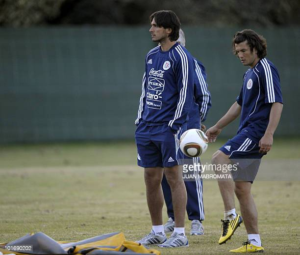 Paraguay's forward Roque Santa Cruz looks on next to forward Nelson Haedo during a training session at the Michaelhouse School in Balgowan on June 7...