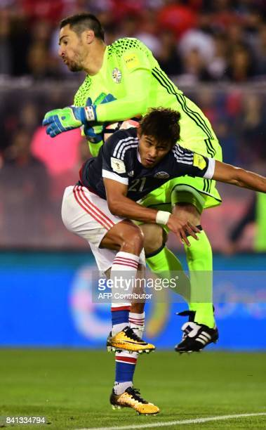Paraguay's goalkeeper Antony Silva collides with teammate Oscar Romero during the 2018 World Cup qualifier football match against Chile in Santiago...