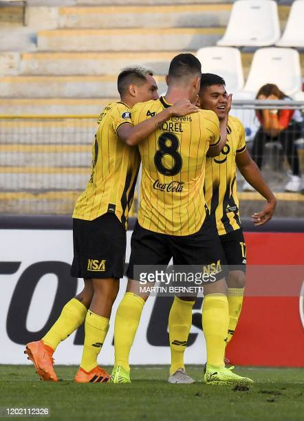 Paraguay's Guarani player Rodney Redes celebrates with teammates his goal against Chile's Palestino during their Copa Libertadores football match at...