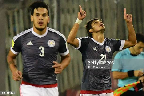 Paraguay's Gustavo Gomez and Oscar Romero celebrate after Chile's Arturo Vidal scored an own goal during their 2018 World Cup qualifier football...