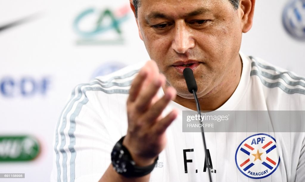 paraguay s head coach francisco arce gives a press conference at the roazhon park stadium in rennes