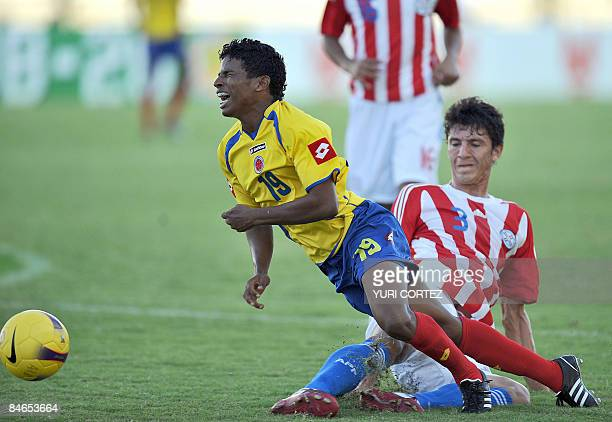 Paraguay's Hernan Pertuz fouls Colombia's Cristian Mejia in the penalty area during their U-20 South American Championship football match on February...