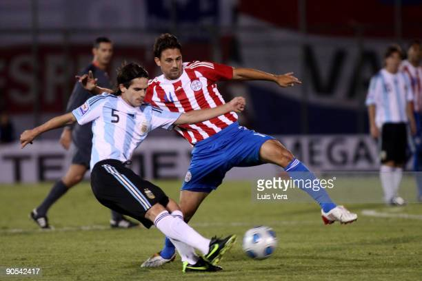 Paraguay's Jonathan Santana vies for the ball with Eduardo Gago of Argentina during their 2010 FIFA World Cup qualifier at the Defensores del Chaco...