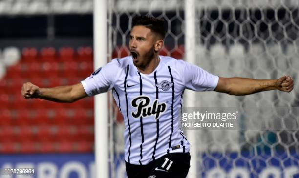 Paraguay's Libertad Adrian Martinez celebrates after scoring against Chile's Universidad Catolica during their Copa Libertadores football match at...