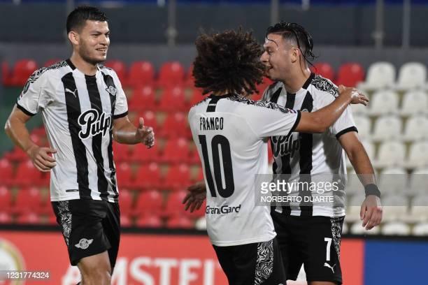 Paraguay's Libertad Carlos Ferreira celebrates after scoring a goal against Ecuador's Universidad Catolica during the Copa Libertadores football...