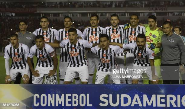 Paraguay's Libertad football team pose during the Copa Sudamericana semifinal second leg football match against Argentina's Independiente at...