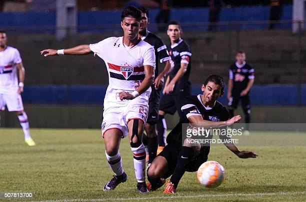 Paraguay's Libertad player Andres Avalos vies for the ball with Araujo of Brazil's Sao Paulo during their Copa Libertadores U20 football match at the...