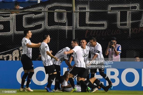 Paraguay's Libertad player Matias Espinoza celebrates with teammates after scoring against Argentina's Rosario Central during their Copa Libertadores...