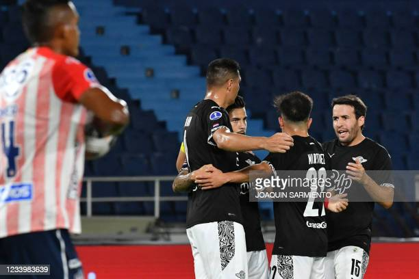 Paraguay's Libertad players celebrate after scoring a goal during the Copa Sudamericana round of 16 first leg football match against Colombia's...