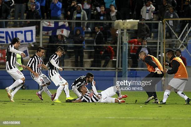 Paraguay's Libertad's player Jorge Recalde celebrates with teammates after scoring against Chile's Universidad Catolica during their Copa...