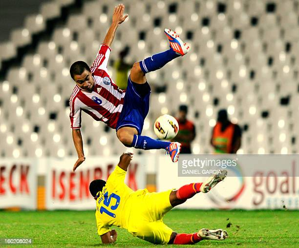 Paraguay's midfielder Angel Cardozo vies for the ball with Ecuador's midfielder Michael Arboleda during their South American U20 final round football...