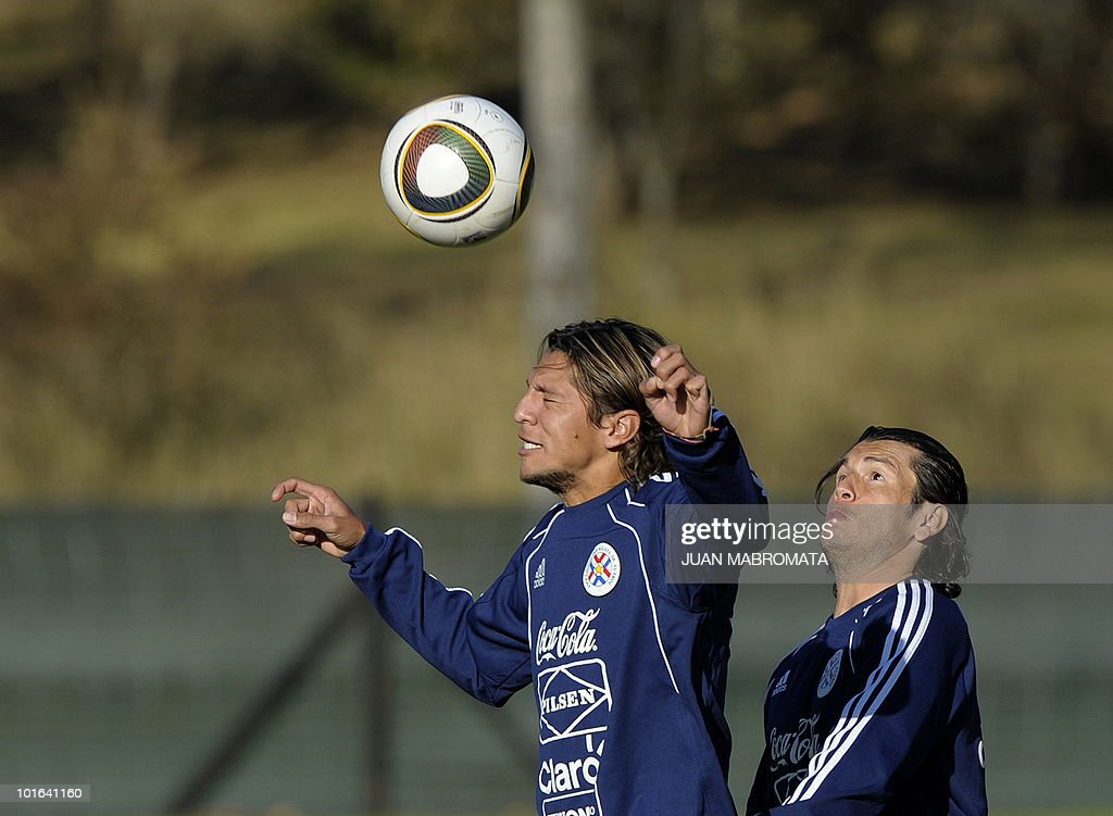 Paraguay's midfielder Enrique Vera (L) and forward Nelson Haedo vie for the ball during a training session at the Michaelhouse school in Balgowan on June 5, 2010. Pararguay will face Italy in their opening match of the 2010 World Cup South Africa in Cape Town on June 14.