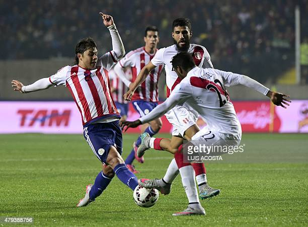 Paraguay's midfielder Oscar Romero vies for the ball with Peru's midfielders Carlos Ascues and Josepmir Ballon during the Copa America third place...