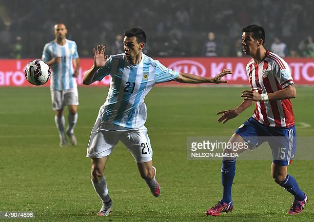Paraguay's midfielder Victor Caceres vies fopr the ball with Argentina's midfielder Javier Pastore during their Copa America semifinal football match...