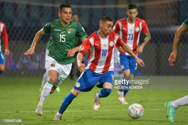 Paraguay's Miguel Almiron and Bolivia's Boris Cespedes vie for the ball during their Conmebol Copa America 2021 football tournament group phase match...
