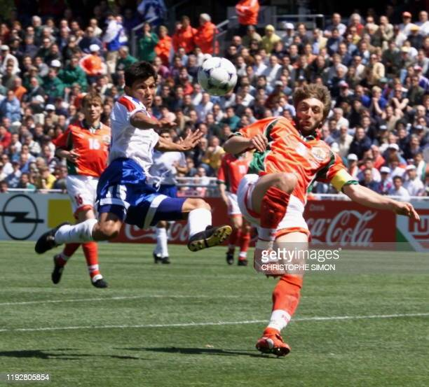 Paraguay's Miguel Benitez kicks the ball in the air in front of Bulgarian Trifon Ivanov 12 June at the Stade de la Mosson in Montpellier during their...
