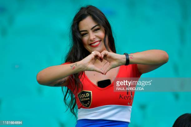 Paraguay's model Larissa Riquelme poses for pictures before the start of the Copa America football tournament group match against Colombia at the...