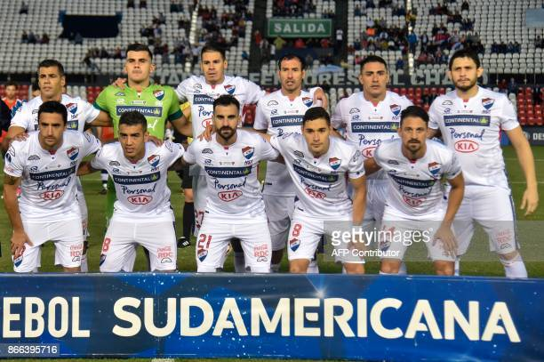 Paraguay's Nacional footballers pose before the start of the 2017 Sudamericana Cup football match against Argentina's Independiente at Defensores del...