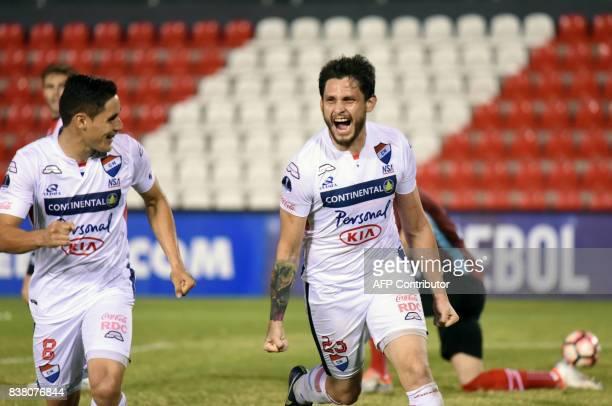 Paraguay's Nacional player Luis Caballero celebrates with teammates after scoring against Argentina's Estudiantes de la Plata during their 2017 Copa...