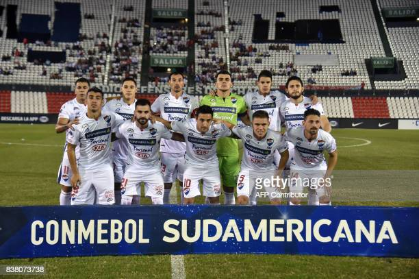 Paraguay's Nacional players pose before their 2017 Copa Sudamericana football match against Argentina's Estudiantes de la Plata at Defensores del...