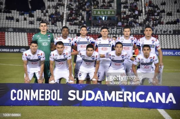 Paraguay's Nacional players pose for pictures before the start of their 2018 Copa Sudamericana football match against Brazil's Botafogo at Defensores...