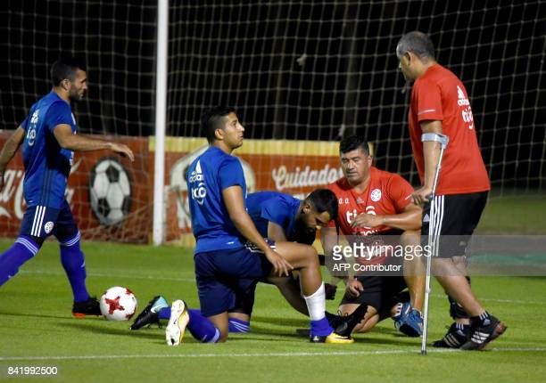 Paraguay's national football team coach Francisco Arce gives instructions to his player Cecilio Dominguez during a training session at the Complejo...