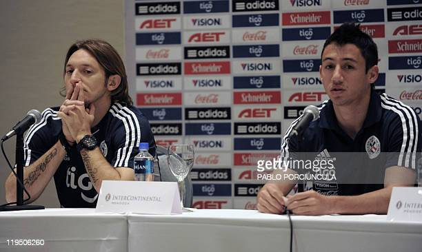 Paraguay's national football team players Edgar Barreto and Ivan Piris give a press conference in Mendoza Argentina on July 21 2011 Paraguay defeated...