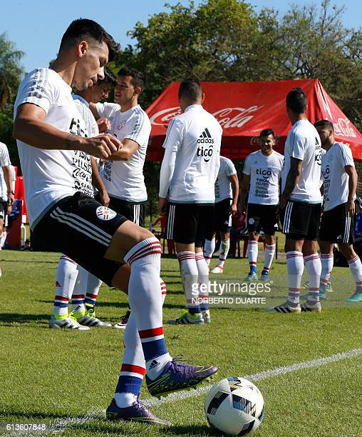 Paraguay's national footballer Hernan Perez attends a training session at the Complejo Albiroga training centre in Ypane near Asuncion on October 9...