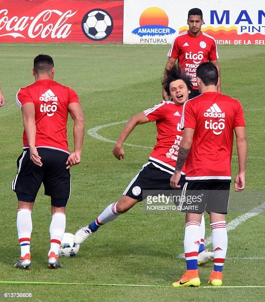 Paraguay's national footballer Oscar Romero and his teammates take part in a training session at the Complejo Albiroga training centre in Ypane near...