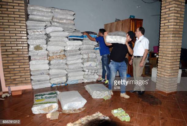 Paraguay's National Police officers seize a hoard of 50 and 100 Venezuelan Bolivar bills weighing about 30 tons at a house in Salto del Guaira...