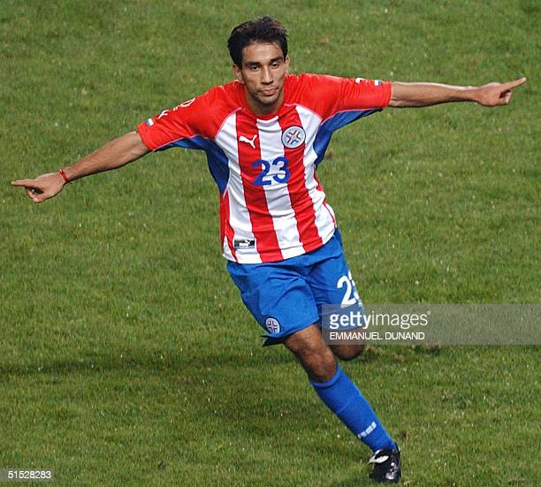 Paraguay's Nelson Cuevas celebrates his second goal of the night in the 84th minute 12 June 2002 at the Jeju World Cup Stadium in Seogwipo during...
