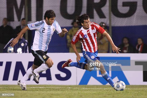 Paraguay's Nelson Haedo vies for the ball with Papa of Argentina during their 2010 FIFA World Cup qualifier at the Defensores del Chaco Stadium on...