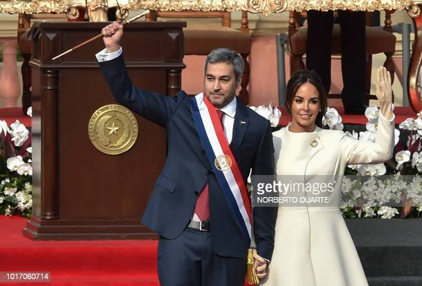 TOPSHOT Paraguay's new President Mario Abdo Benitez walks next to his wife Silvana Lopez Moreira during his inauguration ceremony in Asuncion on...