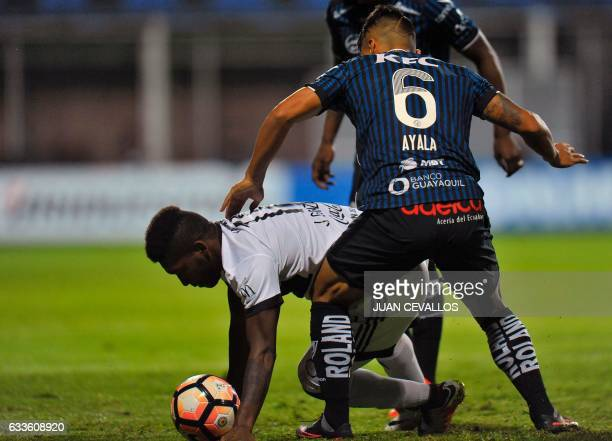 Paraguay's Olimpia Jonathan Gonzales vies for the ball with Ecuador's Independiente del Valle Luis Ayala during their Libertadores Cup football match...