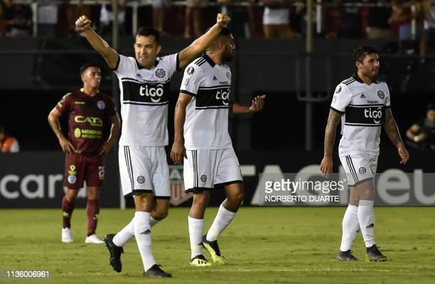 Paraguay's Olimpia player Nestor Camacho celebrates after scoring against Argentina's Godoy Cruz during their Copa Libertadores football match at...