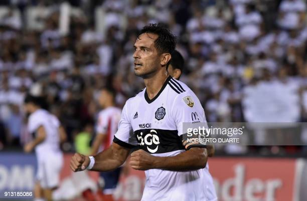 Paraguay's Olimpia player Roque Santa Cruz celebrates after scoring against Colombia's Junior during their Libertadores Cup football match at the...