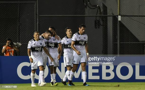 Paraguay's Olimpia players celebrate after scoring against Argentina's Godoy Cruz during their Copa Libertadores football match at Defensores del...