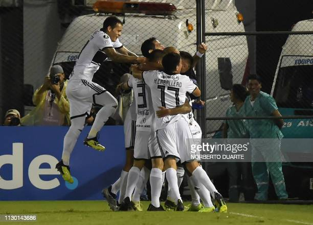Paraguay's Olimpia players celebrate after scoring against Chile's Universidad de Concepcion during their Copa Libertadores football match at...